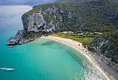 Aerial view of the amazing beach of Cala Luna and the mouth of the river Codula di Luna, Orosei gulf, Nuoro district, Ogliastra, Sardinia, Italy.