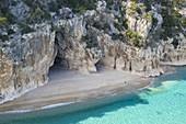 Aerial view of the amazing beach and caves of Cala Luna, Orosei gulf, Nuoro district, Ogliastra, Sardinia, Italy.
