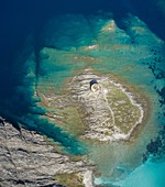 Aerial view of the small island and the medieval tower of La Pelosa, Stintino, Asinara Gulf, Sassari district, Sardinia, Italy.