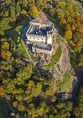 Aerial view of the medieval Bellinzona castles, Unesco World Heritage site, in autumn at sunset. Canton Ticino, Switzerland.