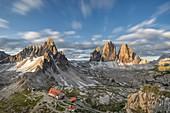 Sesto / Sexten, province of Bolzano, Dolomites, South Tyrol, Italy. Sunrise at the Tre Cime di Lavaredo, Mount Paterno and refuge Locatelli