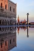 High tide (acqua alta) in St Mark's Square with San Giorgio Maggiore in the background, Venice, Veneto, Italy, Europe