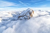 Winter aerial view of Tofana di Rozes in a sea of clouds, Dolomites, Belluno province, Veneto, Italy