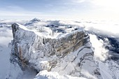 Rock face of majestic Monte Pelmo in winter, aerial view, Dolomites, Belluno province, Veneto, Italy