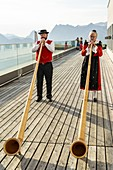 Alphorn players with traditional clothing, Muottas Muragl, Samedan, canton of Graubunden, Engadine, Switzerland
