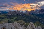 Burning sky at sunset over Giau Pass, Lagazuoi, Cinque Torri and Tofane, aerial view, Dolomites, Belluno, Veneto, Italy