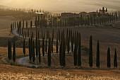 Baccoleno farmhouse at sunset,Asciano,Siena province,Tuscany,Italy.