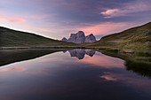 The Pelmo massif is reflected in Lake Baste at the first light of a summer day, Mondeval, Dolomites