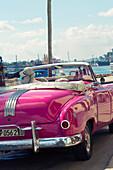 Pink classic car in Cuba, Havana