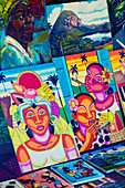 Colourful Cuban paintings on a market in Viñales