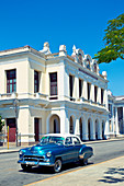 Classic blue car in front of Teatro Thomas Terry in Cienfuegos, Cuba