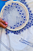 Detail of a woman who embroiders in Trinidad, Cuba