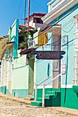 Exterior and sign board of the Canchanchara Bar in Trinidad, Cuba
