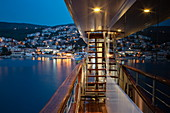 Deck of cruise ship with town behind at dusk, Rabac, Istria, Croatia, Europe