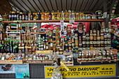 Woman sells local specialties at a market stall, Pula, Istria, Croatia, Europe
