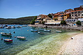 Small fishing and pleasure boats moored near the beach, Rabac, Istria, Croatia, Europe
