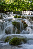 Fast flowing water cascades over rocks, Plitvice Lakes National Park, Lika-Senj, Croatia, Europe