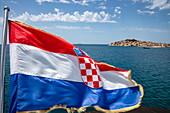 Croatian national flag on board the cruise ship, Primosten, Šibenik-Knin, Croatia, Europe