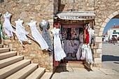 White dresses blowing in the wind for sale at Butique Greta in the old town, Primosten, Šibenik-Knin, Croatia, Europe