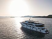 Aerial view of cruise ship at anchor in pristine bay, near Kukljica, Zadar, Croatia, Europe