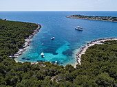 Aerial view of the cruise ship and other boats in a pristine bay at a swim stop for passengers, near Kukljica, Zadar, Croatia, Europe