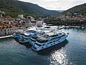Aerial view of cruise ships and excursion boats docked next to old town, Vis, Vis, Split-Dalmatia, Croatia, Europe