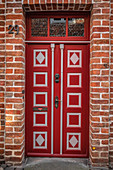 Old red door in the old town of Lueneburg, Germany