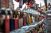Love locks on a bridge in the old town of Lueneburg, Germany