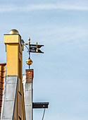 View of the weather vane in the old town of Lueneburg, Germany