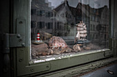 Shop window with ship and lighthouse in Wismar, Germany