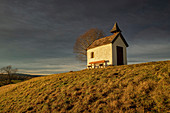 The chapel at Riegsee in the evening in early spring, Aidling, Murnau, Bavaria, Germany