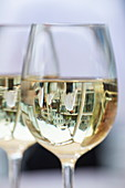 White wine glasses with reflection on board the river cruise ship during a cruise on the Rhine, Koblenz, Rhineland-Palatinate, Germany, Europe