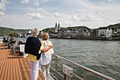 Couple on sundeck of river cruise ship during a cruise on the Rhine, Boppard, Rhineland-Palatinate, Germany, Europe
