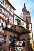 Angel fountain in front of half-timbered houses in the old town with tower of the collegiate church, Wertheim, Spessart-Mainland, Franconia, Baden-Wuerttemberg, Germany, Europe