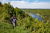 Couple walks along a hill above the Main with a view of the Eichel lock, Wertheim, Spessart-Mainland, Franconia, Baden-Wuerttemberg, Germany, Europe