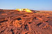 Ethiopia; Afar region; Danakil Desert; Danakil Depression; Dallol geothermal area; Terraced salt crusts in red tones and yellow, sulfur-containing salt cones
