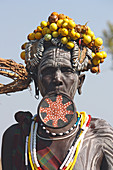 Ethiopia; Southern Nations Region; southern Ethiopian highlands; Mago National Park; lower Omo River; Mursi woman with lip plate and headdress