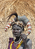 Ethiopia; Southern Nations Region; southern Ethiopian highlands; Mago National Park; lower Omo River; elderly Mursi woman with headdress and face and body painting;