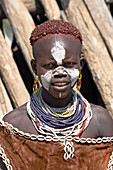 Ethiopia; Southern Nations Region; southern Ethiopian highlands; Kolcho village on the Omo River; young Hamer girl with typical hairstyle, face-painting and jewelry