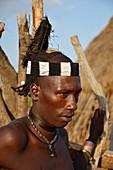 Ethiopia; Southern Nations Region; Hamer village near Turmi; young Hamer man with headdress