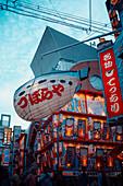 Puffer fish advertising on an amusement street in the Shinsekai neighborhood of Osaka, Japan