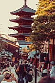 Tourists take photos of a historic temple in Kyoto, Japan