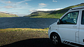 VW camper van in front of the fjord on the Faroe Islands