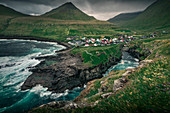 Village of Gjogv on Eysteroy with gorge, sea and mountains, Faroe Islands