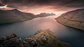Panorama at the Klakkur viewpoint near Klaksvik on the island of Bordaoy with a view of Klasoy and Kunoy in sunset, Faroe Islands