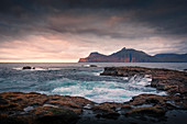 Sea at Gjogv in sunset with a view of Kalsoy, Faroe Islands