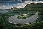 Curve of a road at Oyndarfjørður on the island of Eysteroy, Faroe Islands