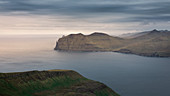 Panorama with Witchesfinger Rock of Streymoy and Vagar with clouds, Faroe Islands