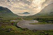 Man on the winding road to Norðradalur on Streymoy, Faroe Islands