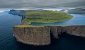 Coast, waterfall and cliffs at Trælanípa on the island of Vagar, on Lake Leitisvatn, Faroe Islands